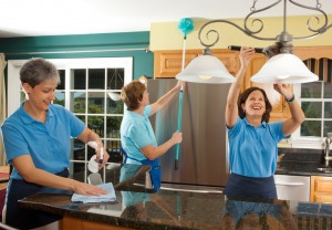 Group Of Woman Cleaning The Kitchen