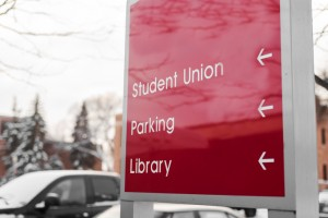 campus sign giving directions to various places