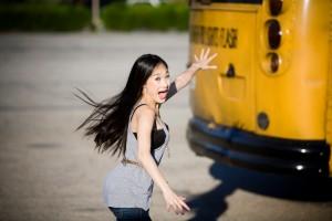Asian girl running late for bus