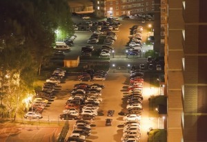 Top view of the Parking of cars near high-rise buildings.