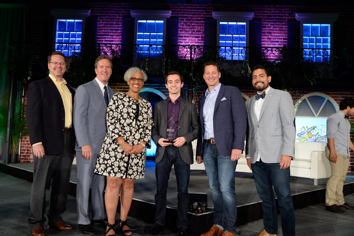 Last year's winner pictured onstage with judges and IPI CEO, Shawn Conrad.